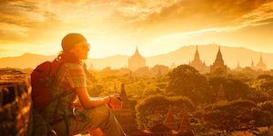 Young traveller enjoying a looking at sunset on Bagan, Myanmar Asia.  Traveling along Asia, active lifestyle concept